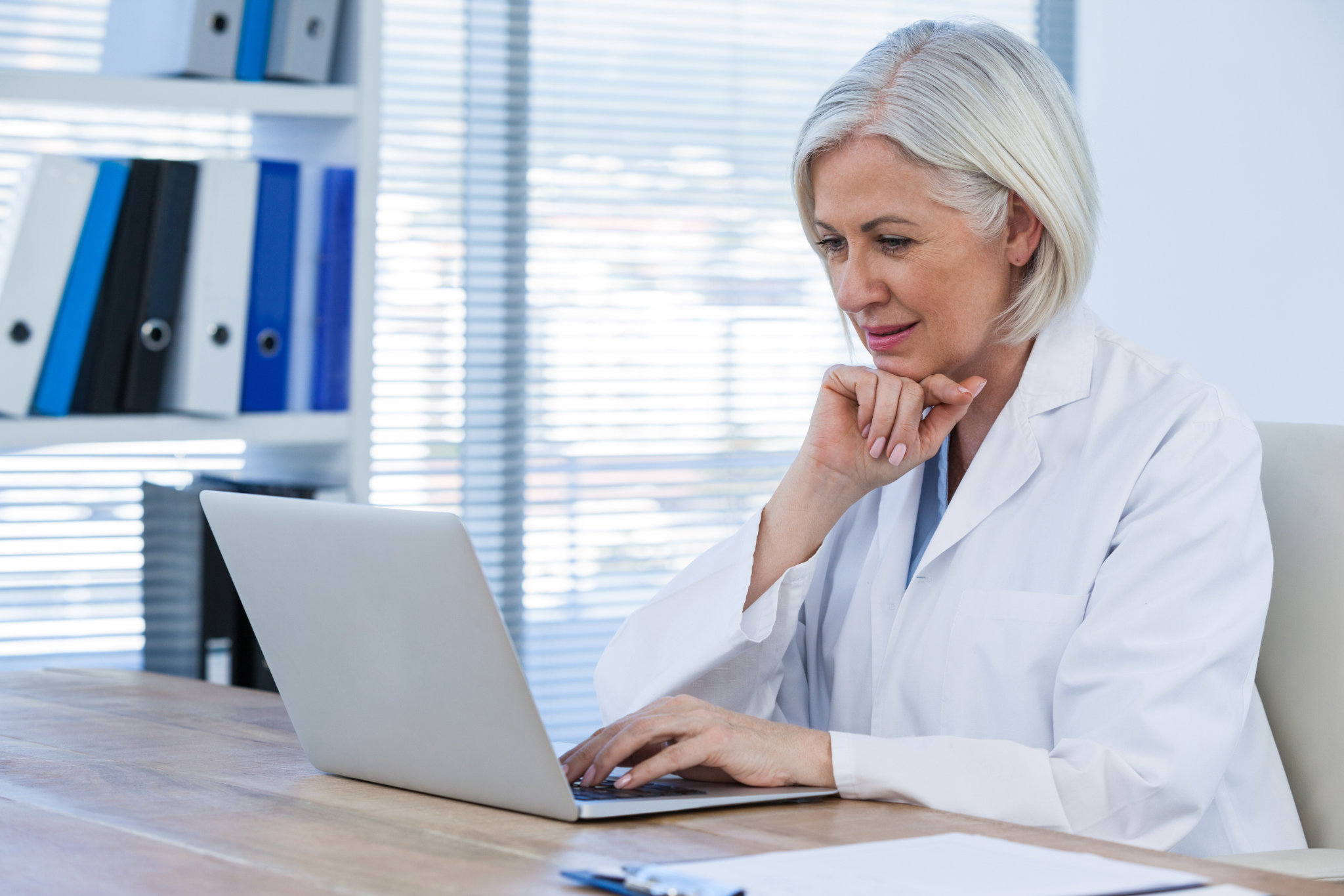 Woman Doctor at desk